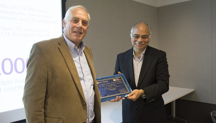 Dr. Shivendra Panwar Electrical and Computer Engineering & Director, CATT presents Dr. Roberto Padovani with a plaque commemorating his presentation in the Jack Keil Wolf Lecture Series